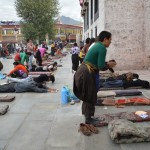 People worshiping outside the Jokhang Temple