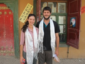 Receiving our traditional scarves from our Tibet tour guide after his and the driver's arrival