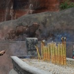 Incense offerings at the foot of the Buddha
