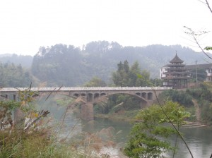 Bridges and buildings like this lined much of the road through SW Hunan
