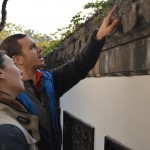 Byron and Amy discussing whether or not the tiles are authentic and what the symbols represent