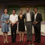 Posing on stage with the founder of Free Lunch for Children, Deng Fei, after a TV interview event we participated in.